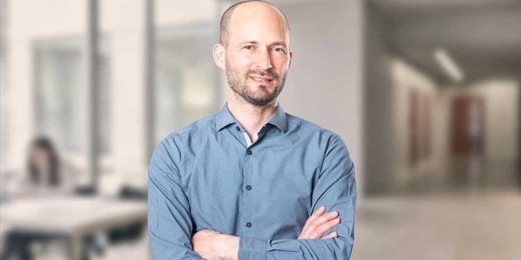 Dr. Christian Winiker